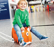 Child sitting on a Trunki Suitcase